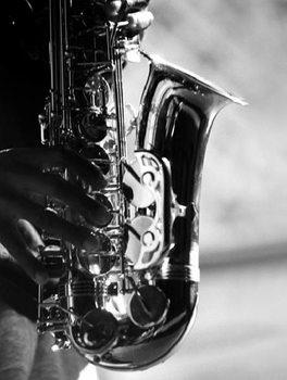 Hands of saxophonist playing Reproduction