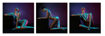 Nude woman in a black background Mounted Art Print