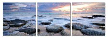 Rocks on a beach Mounted Art Print