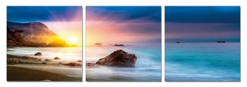 Sunset behind a rock Mounted Art Print