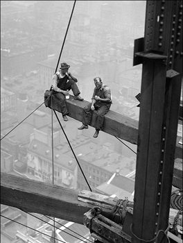 Workers sitting on steel beam 1926  Reproduction