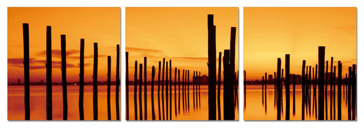 Golden sunset over pier Mounted Art Print