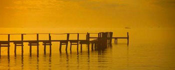 Pier With Orange Sky Reproduction