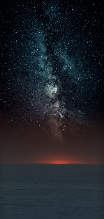 Art Print on Demand Astrophotography picture of sunset sea landscape with milky way on the night sky.