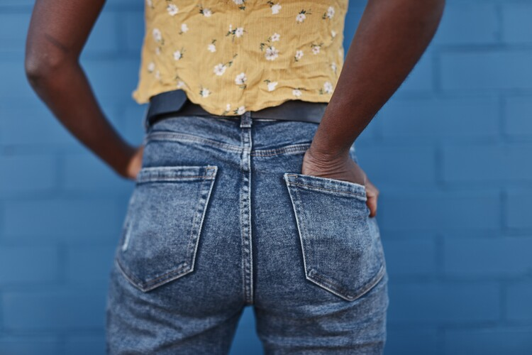 Art Print on Demand jeans over blue wall