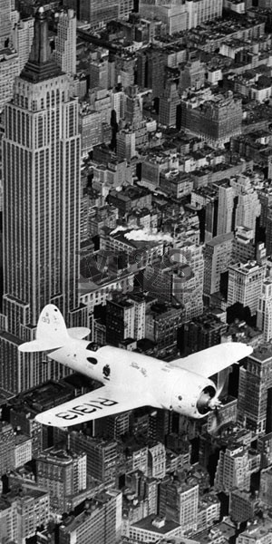 Hawks airplane in flight over New York city 1937  Art Print