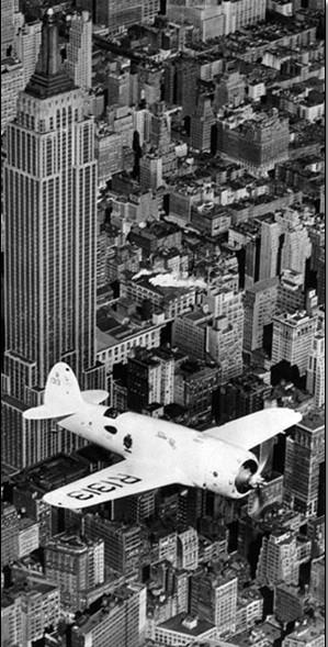 Hawks airplane in flight over New York city, 1938 Art Print