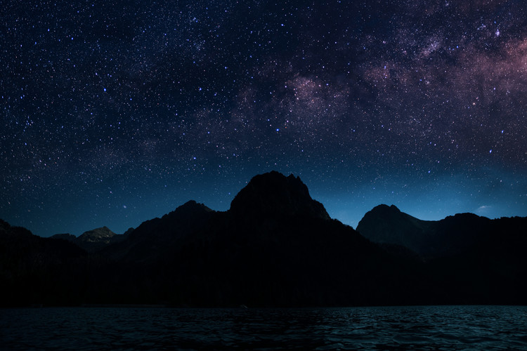 Wallpaper Mural Astrophotography picture of Sant Mauricio landscape with milky way on the night sky.