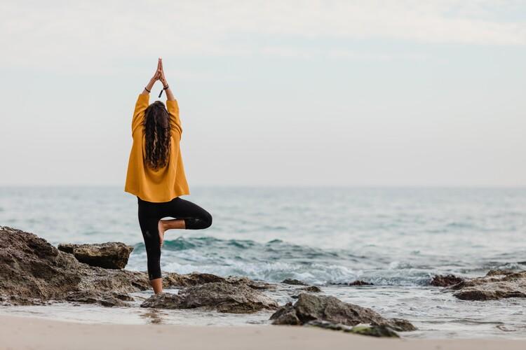 practicing yoga at beach Wallpaper Mural