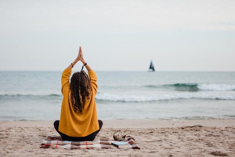 Wallpaper Mural practicing yoga at beach