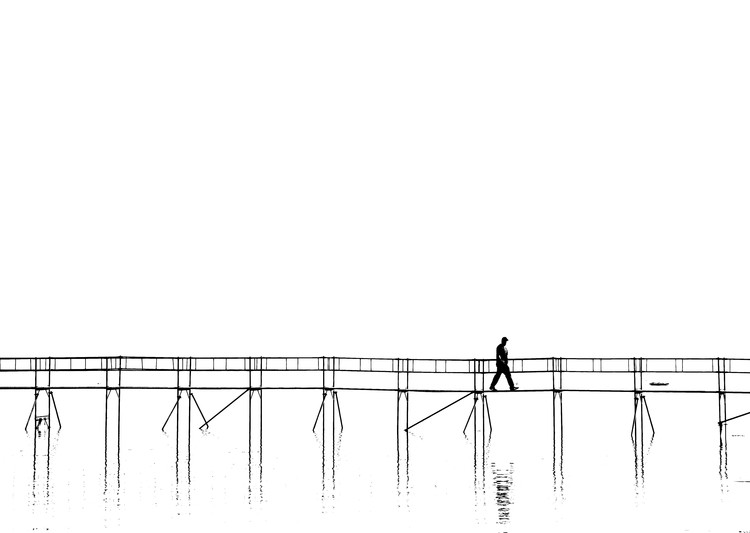 The lonely man on the plank bridge Wallpaper Mural