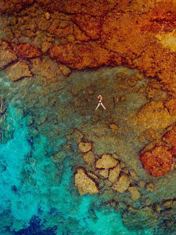 Woman swiming at sea Wallpaper Mural